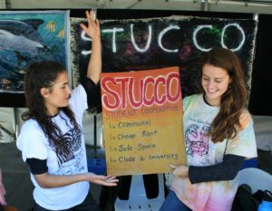 Yolanda and Jess show off Stucco's amazing qualities (in equally amazing DIY Stucco shirts)